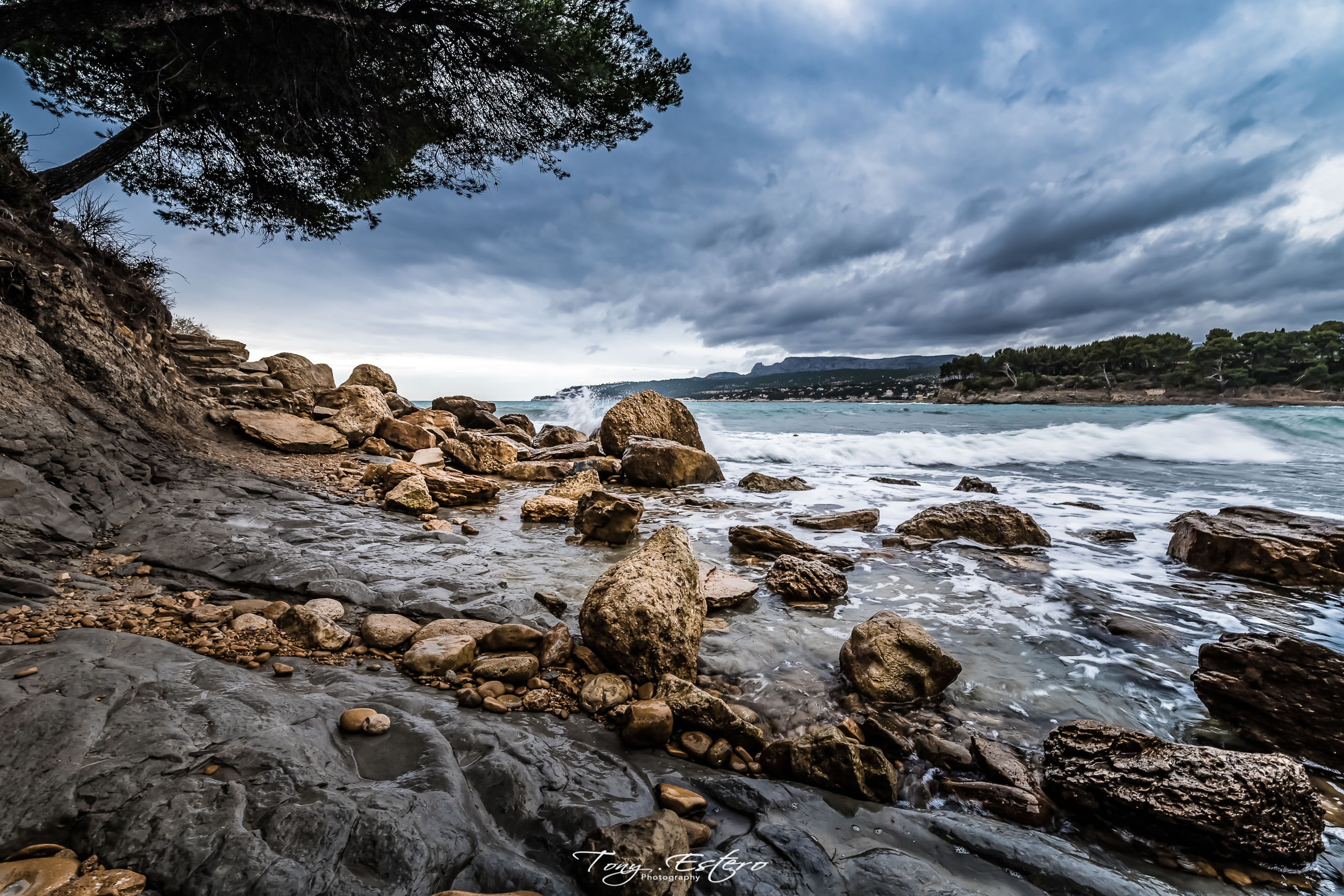 sky, cloud - sky, rock, water, solid, rock - object, beauty in nature, scenics - nature, sea, tranquil scene, tranquility, no people, nature, beach, land, day, non-urban scene, tree, motion, outdoors, rocky coastline