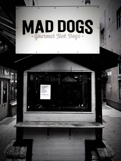 Mad dogs gourmet hot dogs apparently Hot Dog Stand No Hot Dogs Vacant Food Stand No People Blackandwhite Black And White Photography