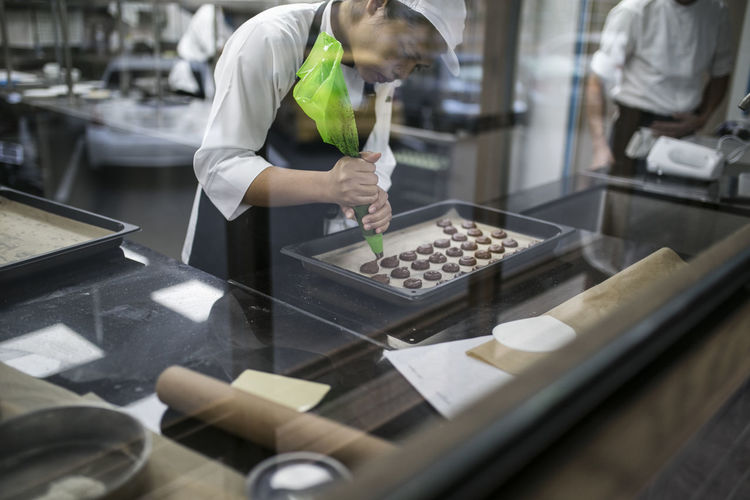 Chef making cookies in bakery