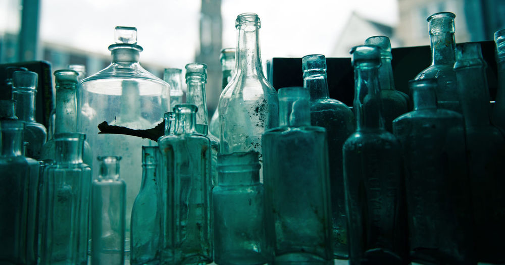 Close-Up Of Various Glass Bottles On Table