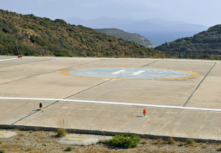 heliport in Lipsi Island, Greece Dodecanese Helipad Sign Transportation Travel Concrete Day Empty Greece Helicopter Platform Heliport Island Landing Place Letter H Lipsi Mountain No People Scenics