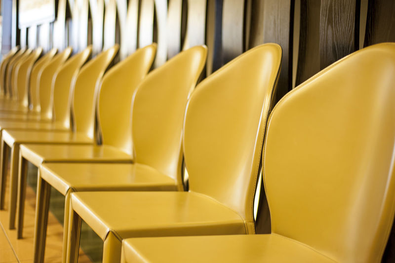 Empty Yellow Chairs Arranged In Row
