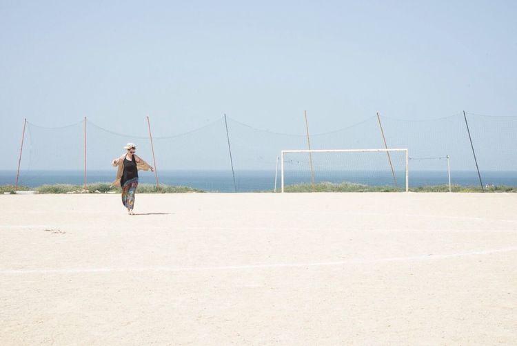 Woman On A Sunny Beach