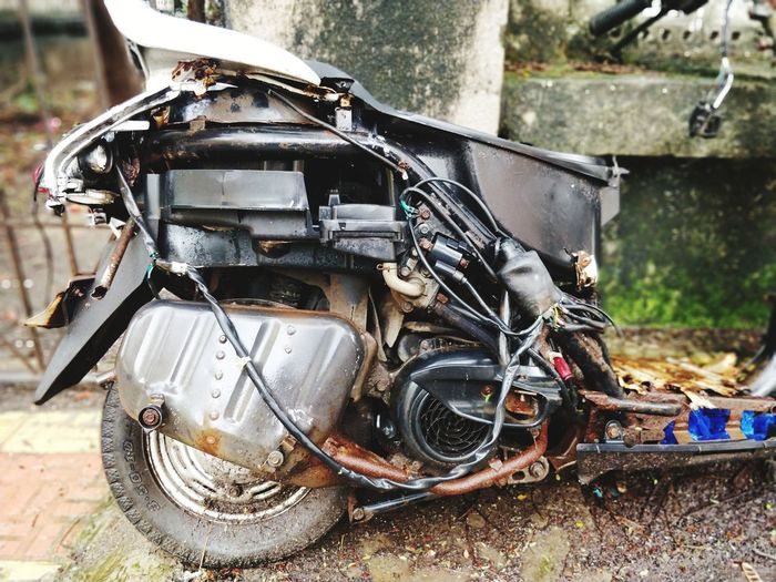 Close-up of abandoned motorcycle on street