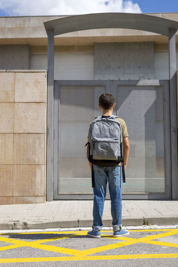 Portrait of a student ( back to school concept ) Student Architecture Building Building Exterior Built Structure Casual Clothing City Day Footpath Full Length Leisure Activity Lifestyles Males  Men One Person Outdoors Real People Rear View School Standing Sunlight Uniform