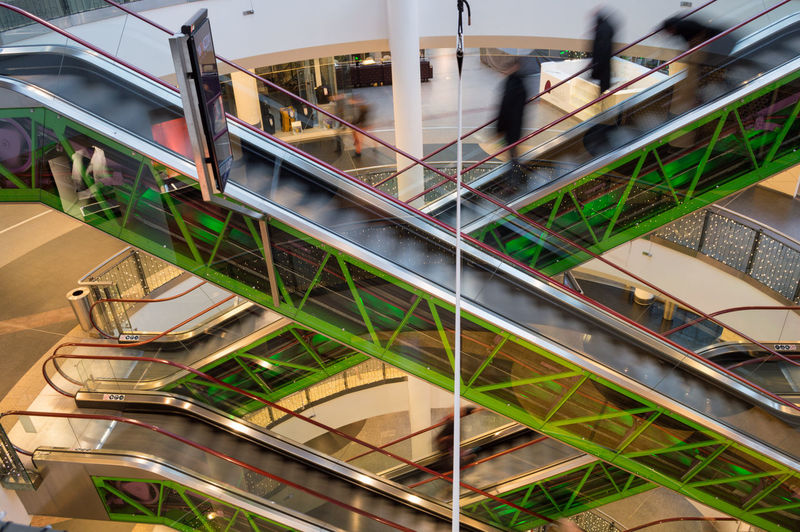 Poland Warsaw Europe Architecture Staircase Blurred Motion Railing High Angle View Steps And Staircases Built Structure Real People Motion Escalator Incidental People Indoors  Modern Lifestyles Group Of People Day People Transportation Glass - Material