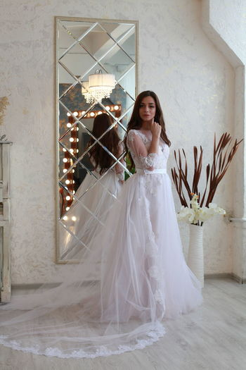 Newlywed Celebration Bride Wedding Wedding Dress Event Real People One Person Fashion Full Length Lifestyles Young Adult Women Clothing Adult White Color Beautiful Woman Young Women Looking At Camera Life Events Teenager Hairstyle Flower Arrangement