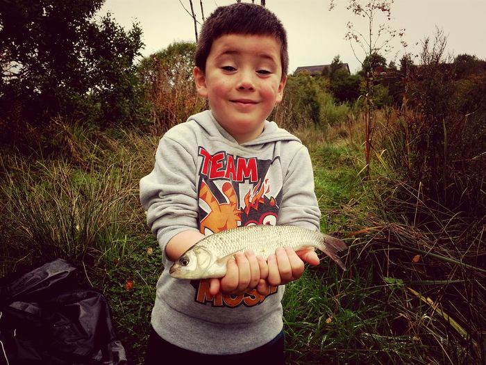 Escaping and Catching Fish my sons first fish he cought all by himself Feeling Proud