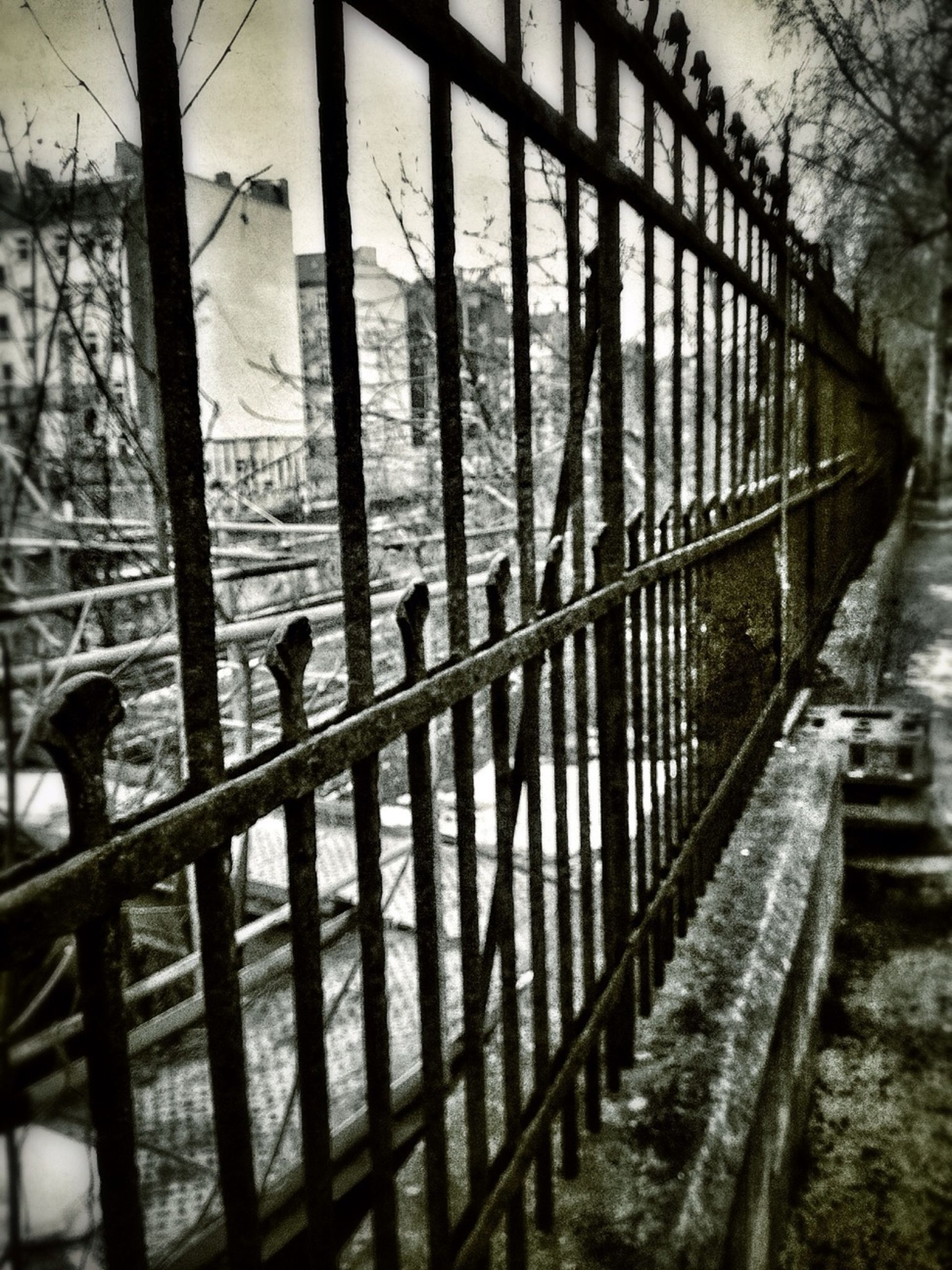 railing, transportation, fence, bridge - man made structure, metal, the way forward, built structure, footbridge, protection, architecture, tree, chainlink fence, sky, connection, safety, incidental people, water, railroad track, sunlight, walking