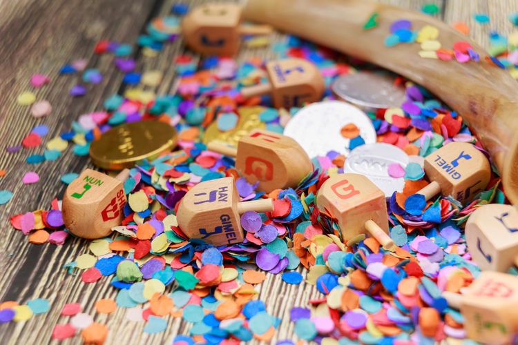 Close-up of confetti and dreidel