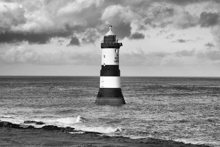 Sea Guidance Lighthouse Sky Water Tower Cloud - Sky Security Built Structure Safety Horizon Over Water Horizon Building Exterior Scenics - Nature Protection Architecture Day Nature Building No People Outdoors Penmon Point