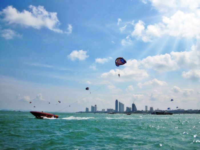 Low angle view of person parasailing at sea