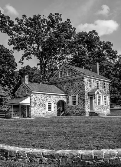 This is a photo of George Washington's Headquarters in Valley Forge National Park. While there are many building in Valley Forge National Historical Park that are original to the time of the encampment, none holds more historical significance than Washington's Headquarters. For most of the six-month encampment, Washington made his home in this stone building, meeting with advisers as they made plans, not only for the encampment, but the continuation of the war. Architecture Blackandwhite Built Structure Cloud Cloud - Sky Cloudy Day EyeEm Best Shots EyeEm Gallery Façade George Washington Grass Growth Headquarters Historical Building History Nature No People Outdoors Pennsylvania Revolutionary War Sky This Week On Eyeem Tree Valley Forge National Park