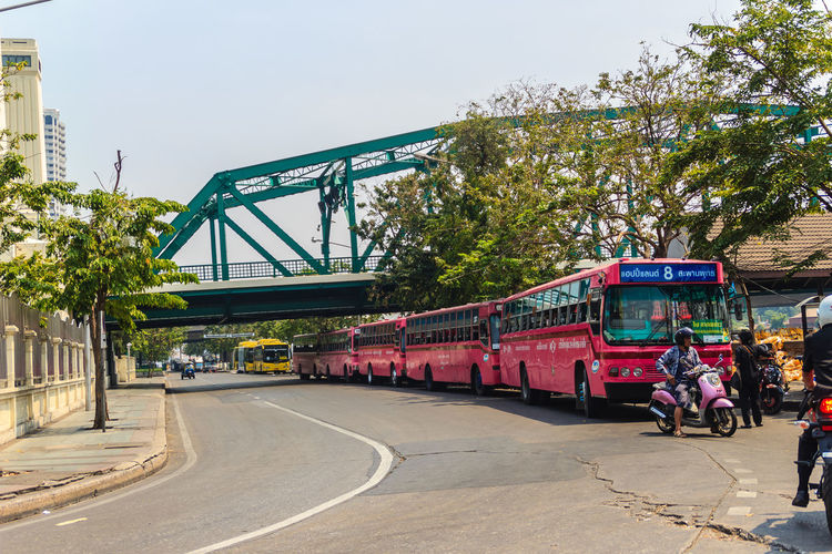 Bangkok, Thailand - March 2, 2017: Pink bus line number 8, starting point from the memorial bridge (Saphan Phut) to Happy Land, Minburi. Bus nummber 8 line is famous of fast and swiftly in Bangkok. Bus Trip Bus Terminal Station - Entrance Number 8 Pink Pink Bus Saphan Phut Architecture Bridge Built Structure Bus Bus Line Bus Terminal Bus Travel City Day Fast And Furious Fast And Furious 8 Fast And Swiftly Group Of People Happy Land Land Vehicle Memorial Bridge Men Minburi Mode Of Transportation Motor Vehicle Nature Outdoors Plant Public Transportation Real People Road Sky Street Sunlight Swiftly Transportation Tree