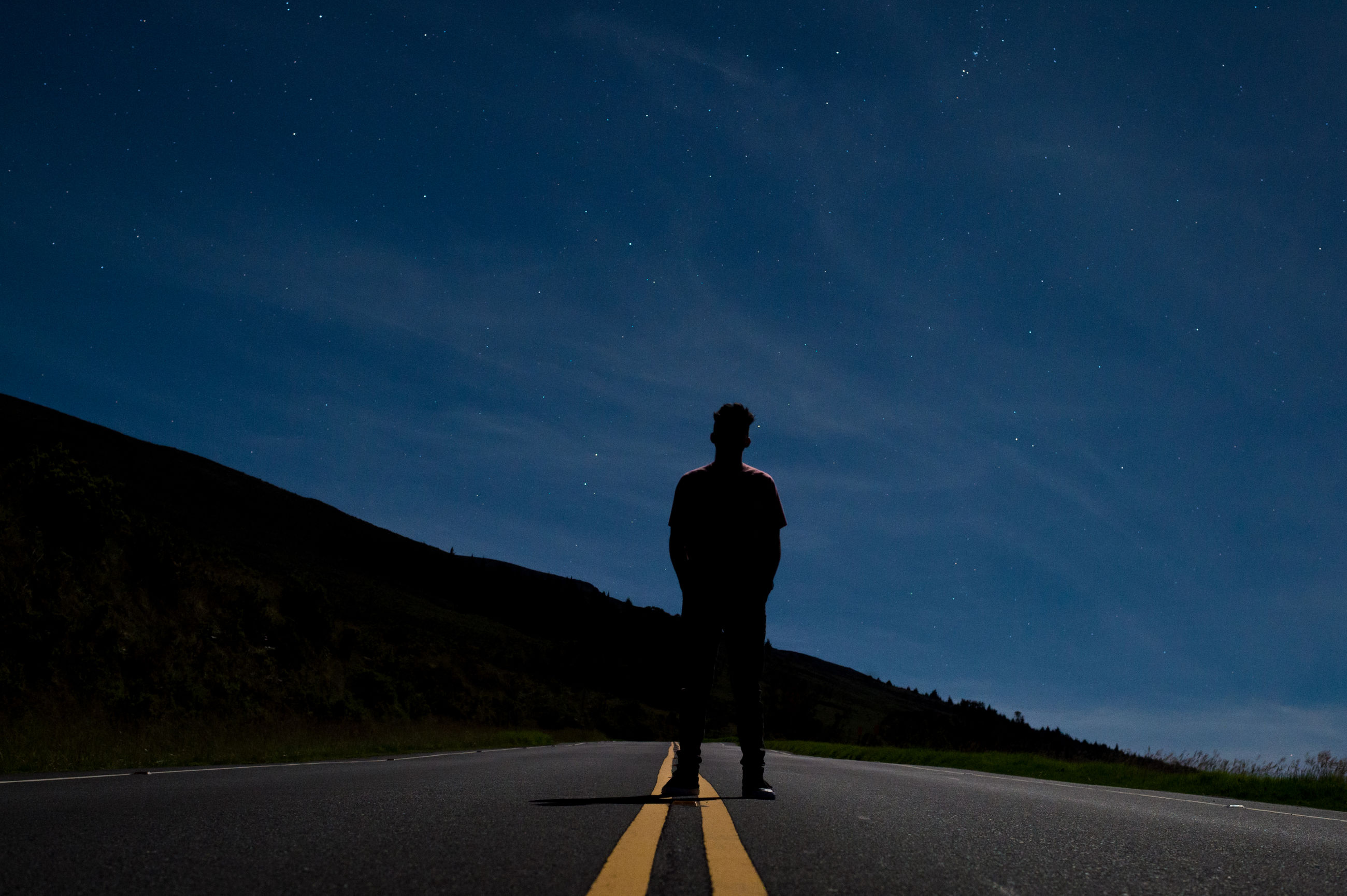 road, one person, real people, the way forward, night, star - space, full length, sky, transportation, nature, scenics, tranquil scene, men, outdoors, astronomy, tranquility, beauty in nature, standing, lifestyles, landscape, space, one man only, galaxy, people