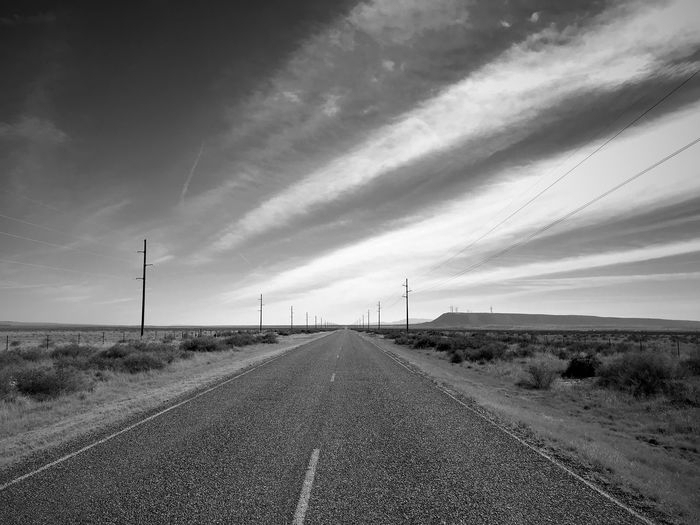 """Infinity"" Vanishing point on a lonely rural highway in Central New Mexico. Roads New Mexico Photography New Mexico Clouds Vanishing Point Rural Road Rural Blackandwhite Photography Black And White Blackandwhite The Way Forward Diminishing Perspective Road Transportation Sky No People Day Landscape"