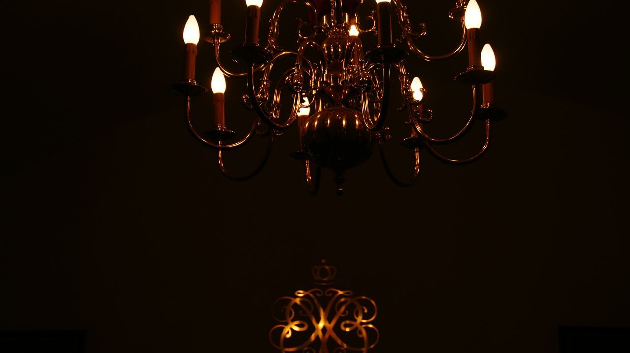 LOW ANGLE VIEW OF ILLUMINATED LIGHT BULB HANGING