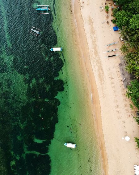Looking down on Pantai Sindhu in Sanur, Bali. Power In Nature Discover The World Dji Global Worlds Best Beaches Beautiful Beach Beautiful Destinations Beautiful Bali Drone Community Island Of The Gods Bali Explore To Create Explore Birds Eye View Dronephotography Island Life Travel Destinations Nature Photography Sindhu Beach Bali From Above Boats High Angle View Aerial View Water Sand Beach Nautical Vessel Nature Beauty In Nature Outdoors Scenics EyeEmNewHere