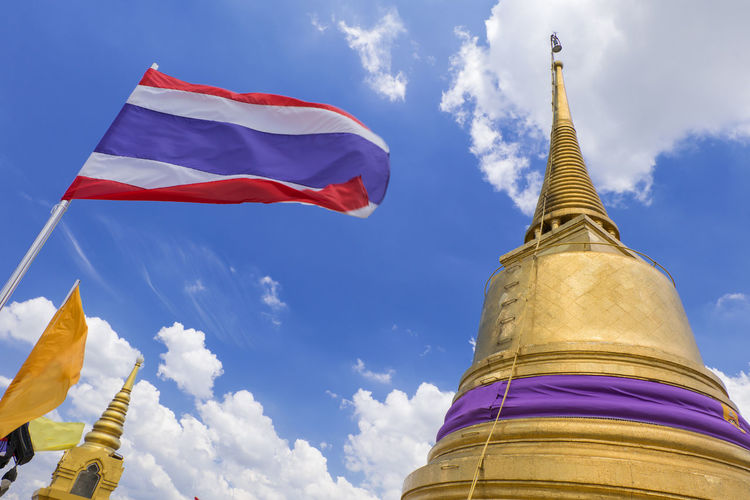 pagoda in temple Architecture Bangkok Blue Buddhism Building Day Flag High Section Nation National Flag Outdoors Pagoda Religion Sky Temple Thailand Tourism Worship