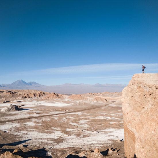 Standing on top of the moon valley in the atacama desert