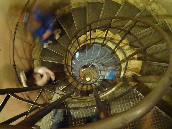 Inside the The Arc de Triomphe de l'Étoile in Paris Arc De Triomphe, Paris Arc De Triomphe De L'Étoile Architecture Paris Paris, France  Architecture Built Structure Indoors  Railing Spiral Spiral Stairs Staircase Stairs Steps Steps And Staircases