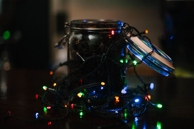 Close-up of illuminated christmas lights on table