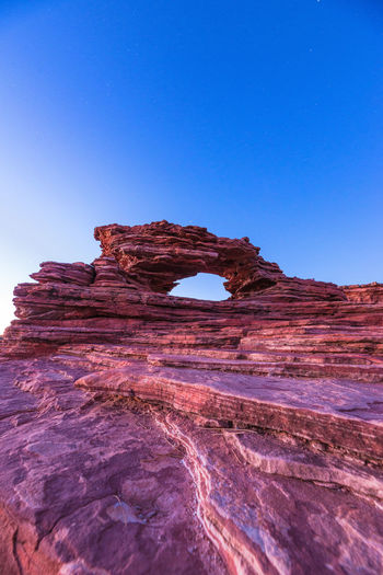 Sky Rock Formation Rock Rock - Object Clear Sky Blue Solid Physical Geography Geology Natural Arch Beauty In Nature Travel Destinations Nature Arch Non-urban Scene Scenics - Nature Tranquility Tranquil Scene No People Eroded Outdoors Climate Arid Climate Sandstone Australia Travel Kalbarri National Park