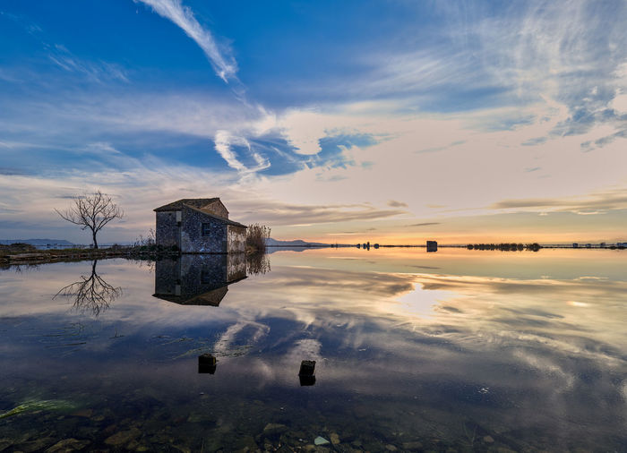 Marjal de la Albufera de Valencia Sunlight Tree Winter Beauty In Nature Cloud - Sky Clouds Clouds And Sky Colorful Day Idyllic Lake Landscape Nature No People Non-urban Scene Outdoors Reflection Scenics - Nature Sky Sun Sunset Tranquil Scene Tranquility Water