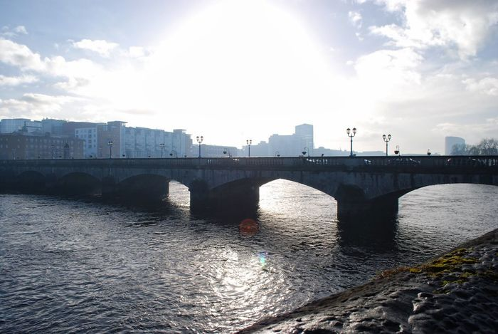 Shannon Bridge in Limerick, Ireland Arch Architecture Bridge Bridge - Man Made Structure Built Structure City Cloud - Sky Connection Day No People Outdoors River Sky Sunlight Transportation Water