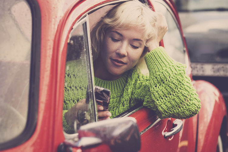 Beautiful blonde woman use cellular phone while drive the red car in the traffic - danger activity traveling with vehicle - millennial people addicted to tecnology everywhere with internet socials Mode Of Transportation One Person Child Real People Childhood Transportation Leisure Activity Lifestyles Girls Front View Holding Females Women Day Land Vehicle Portrait Blond Hair Hair Outdoors Innocence Beautiful Using Phone Mobile Phone Wifi Connection Contact Sharing  Caucasian Casual Clothing Red Old Car Vintage Relaxation Technology Close-up One Woman Only People Green Color