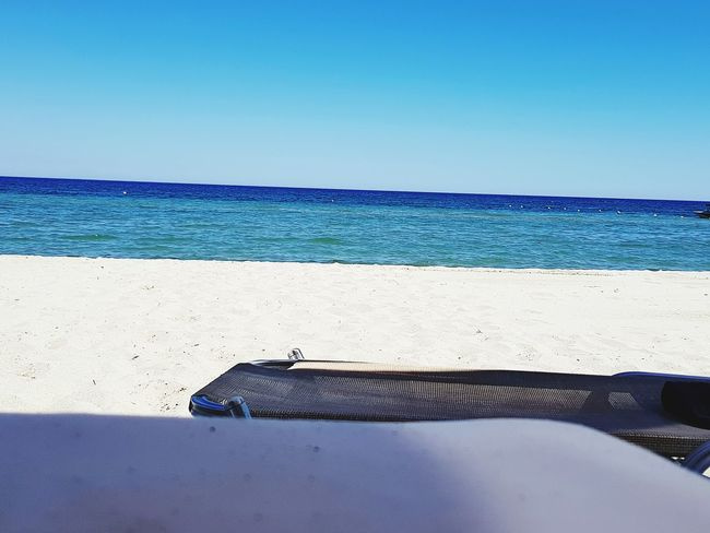 Beach Sea Horizon Over Water Water Sunny Sand Blue Clear Sky Summer Sky Day Outdoors Relaxation No People Tranquility Sunlight Nature Vacations Horizon Wave Beachphotography Beach Life Holidays ☀ Holiday Summertime
