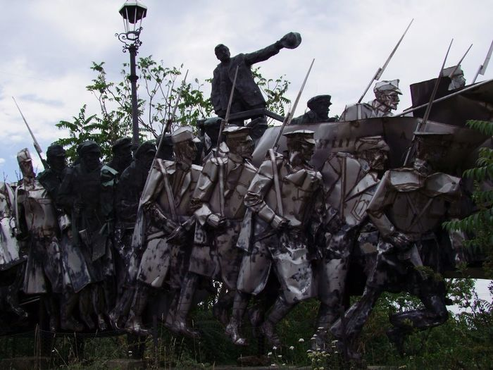 Sculpture of Fighting Soldiers, Momento park Army Budapest Camouflage Clothing Charging Cloudy Sky Communism Communist Era Composition Conflict Full Frame Full Length Guns Hungary Memorial Men Military Military Uniforms Momento Park Outdoor Photography Socialism Soldiers Teamwork Unusual War Weapons Of War
