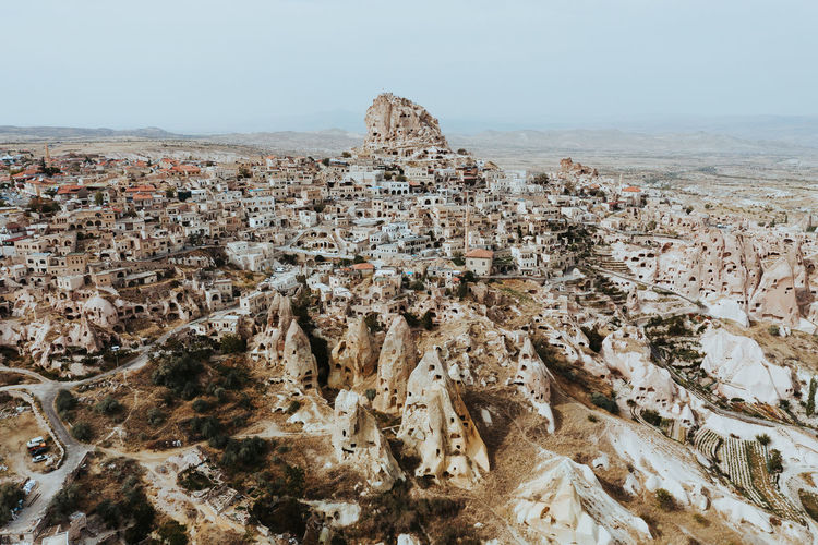 The incredible Uchisar Castle in Cappadocia stands tall over the surrounding dwellings. Week On Eyeem Uçhisar Cappadocia Turkey Travel Destinations Aerial View Drone  Drone Photography Dji Mavic Pro 2 History Ancient Civilization Nature Rock - Object Scenics - Nature Outdoors Physical Geography Environment Eroded Travel Ancient The Past Architecture Sky Rock Formation
