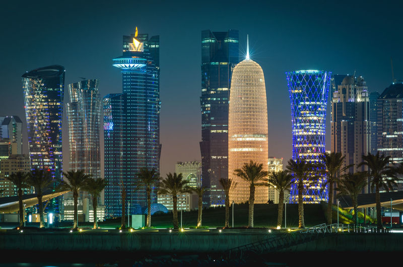 Doha City at night Doha Middle East Architecture Building Building Exterior Built Structure City Cityscape Illuminated Modern Night No People Outdoors Qatar Sky Skyscraper Travel Destinations Tree Urban Skyline