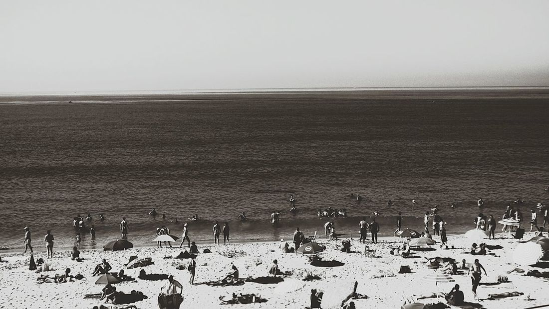 The Leisure Activity People On The Beach Summer2016 Summers Day Black And White Photography Eyeem Black And White Fresh On Eyeem  Eyeemphoto Week On Eyeem Black & White Beach Life People On Beach