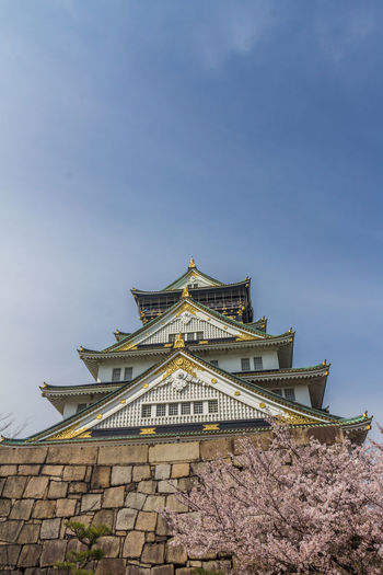 Osaka castle in Japan OSAKA Osaka,Japan Osaka-shi,Japan Osaka Castle Built Structure Architecture Building Exterior Sky Low Angle View Building No People Nature Day Religion Place Of Worship Belief Spirituality Travel Destinations Roof The Past Clear Sky Tree History Outdoors Spire
