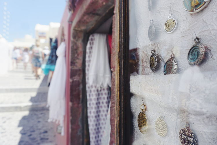 shop in Oia Jewelry Fashion For Sale Greece Santorini Close-up Architecture Sky Building Exterior Built Structure For Sale Display Window Display Retail Display Stall Various Price Tag Shop Fabric