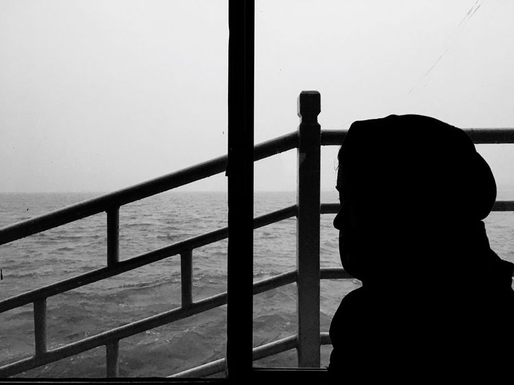 Sea Railing Silhouette One Person Real People Day Water Outdoors Standing People Nature Clear Sky