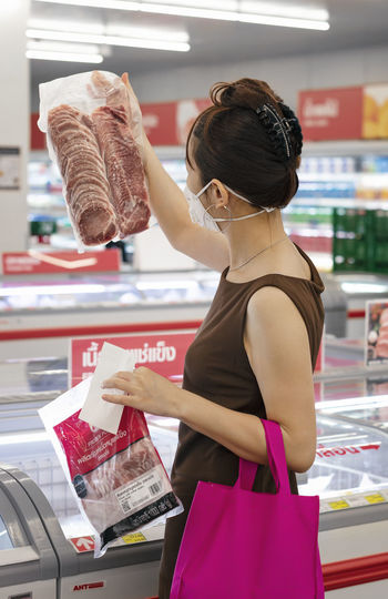 Side view of a woman looking at store