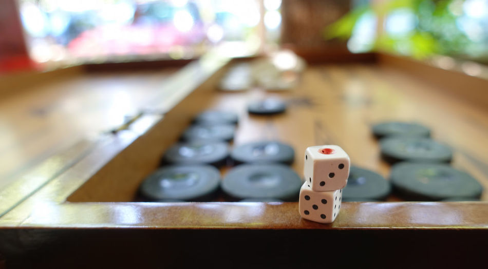 Dice Leisure Games Luck Relaxation Gambling Arts Culture And Entertainment Leisure Activity Table Opportunity Selective Focus Indoors  Wood - Material Close-up Number Still Life Focus On Foreground Board Game No People Game Cube Shape Game Of Chance