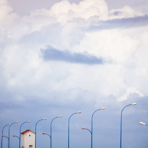 Cloud - Sky Sky Street Light No People Lighting Equipment Low Angle View Day Street Nature Outdoors Technology In A Row Light Built Structure Electric Light Architecture Electricity  Metal Beauty In Nature Building Exterior Repetition Composition Blue Objects Blue House