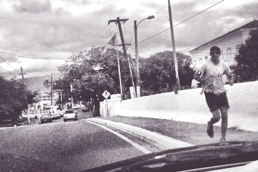 The runner Streetphotography Blackandwhite Streetphoto_bw Life In Motion I Shouldn't Take That Pic While Driving