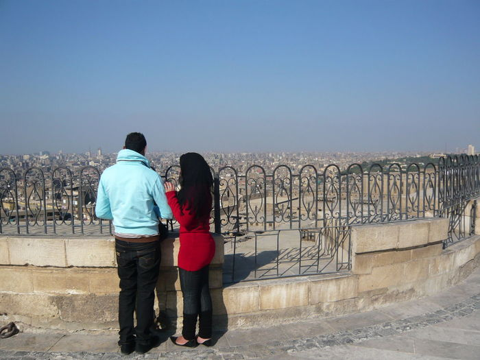 Overlooking Cairo, it's a huge city! Big City Blue Bricks City Life Cityscapes Lifestyles Man And Woman Man And Woman Standing Outdoors Rear View Standing View View From Above Woman In Red Big City Big City View