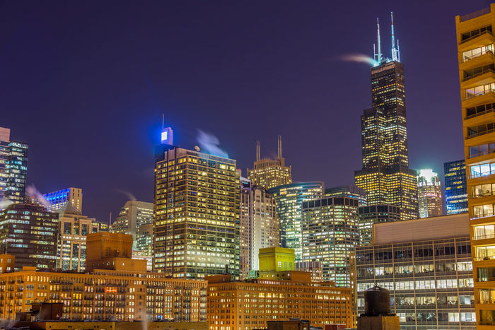 View of Chicago skyscrapers at nighttime Architecture Building Building Exterior Buildings Built Structure Chicago Chicago Architecture City Cityscape Colorful Destination Downtown Downtown Chicago Frozen Hancock HancockTower Horizon Illinois Lake Landmark Modern Office Building Outdoors Panoramic Winter