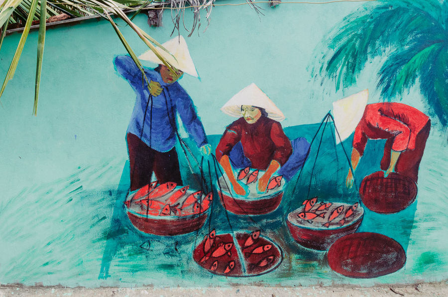 Julien Psomas - Tam Thanh Mural Village. This village has been painted by a group of students from Korea & Vietnam. Its purpose is to create another source of income for this village. It's quite nice to stroll around! Collaborative Art Project Colors Colourful Fisherman Fishermen House Houses Kids Mural Art Painting People Tourism Vietnam Vietnam Trip Village Village Life Wall Wall Painting