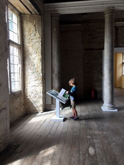 Full Length One Person Casual Clothing Real People Indoors  Day Childhood Built Structure Reading Boy Kirby Hall History Light