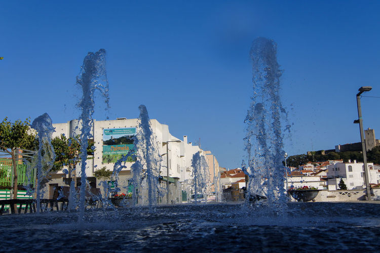Drops Portugal Architecture Blue Building Building Exterior Built Structure City Clear Sky Day Flowing Water Fountain Motion Nature No People Outdoors Portugaldenorteasul Sky Splashing Tranquil Scene Travel Travel Destinations Water Waterfront