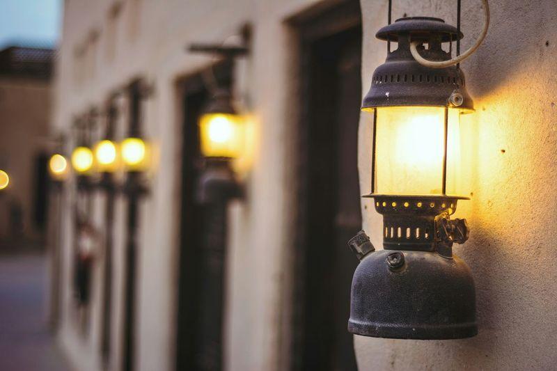 Close-up of lantern hanging outside house