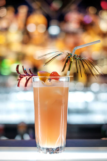 Close-up of singapore sling cocktail on bar counter