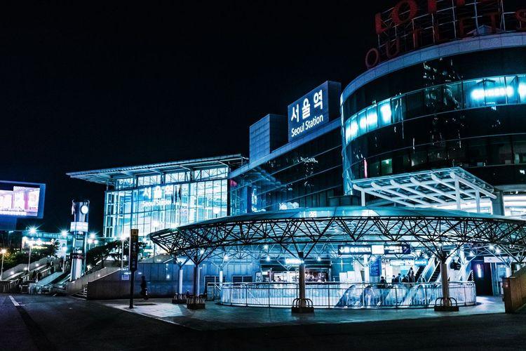 Illuminated modern building against sky at night